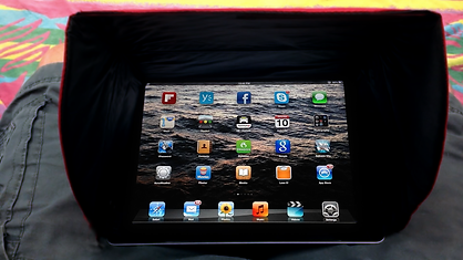 Hoodi shading iPad screen from sunlight glare and light reflection.