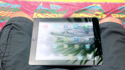 iPad screen with sunlight glare and light reflection