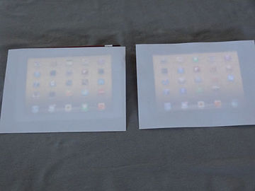 2 iPad screens covered with paper
