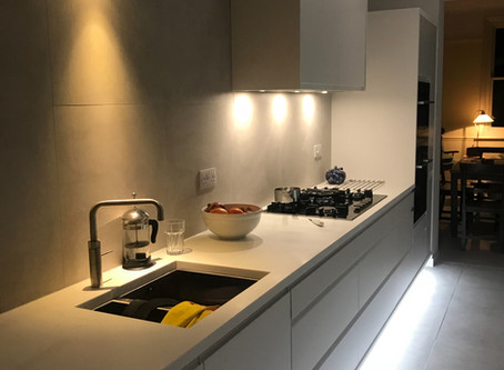 Sleek corian kitchen nearly finished.