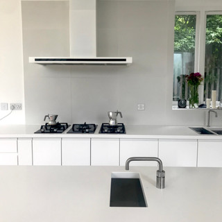 white kitchen design, central island with instant boiling water tap and vola tap on main sink