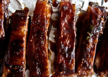 Sticky lamb ribs with honey & orange glaze