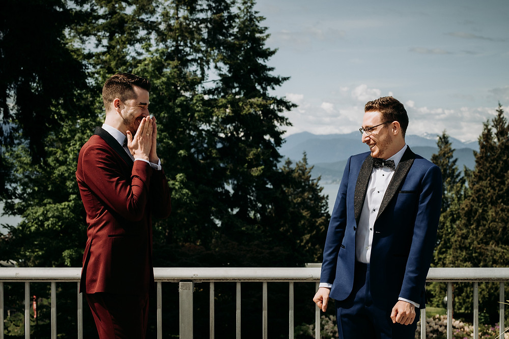 Two men dressed in groom suits see each other for the first time on their wedding day and are emotionl