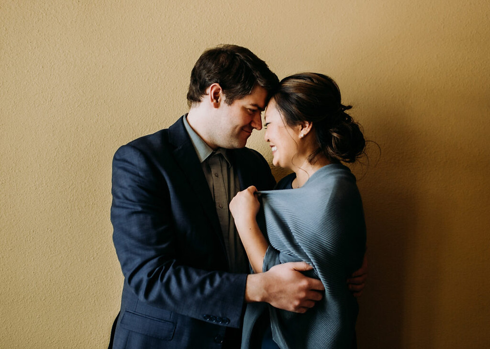well dressed couple hugging during this engagement session