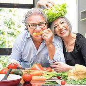 Senior couple having fun in kitchen with