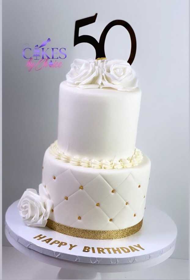 tiered white and gold fondant cake