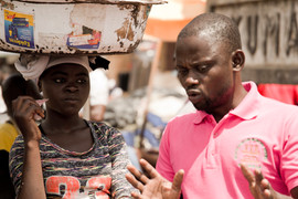 Adamfo employee convincing streetgirls to come to the centre
