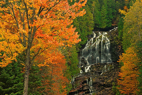 Fall colors frame Colebrook Falls, New Hampshire