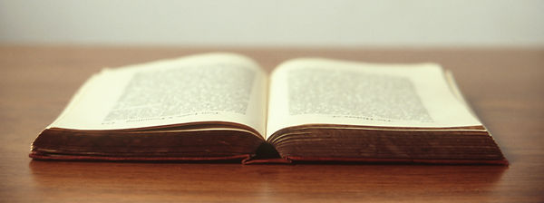 poetry book open on a desk