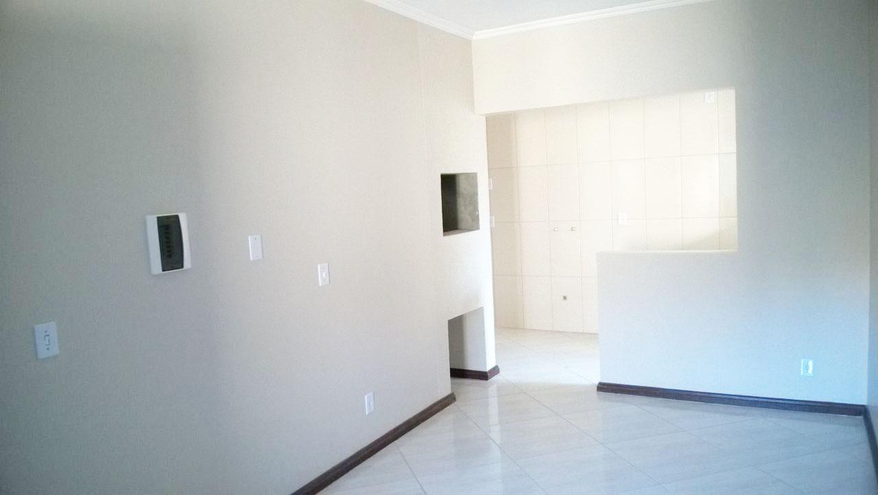 Sala e churrasqueira do apartamento