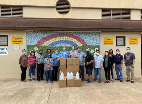 House Representatives, Donors, Volunteers Distribute Hand Sanitizer to Leeward Schools