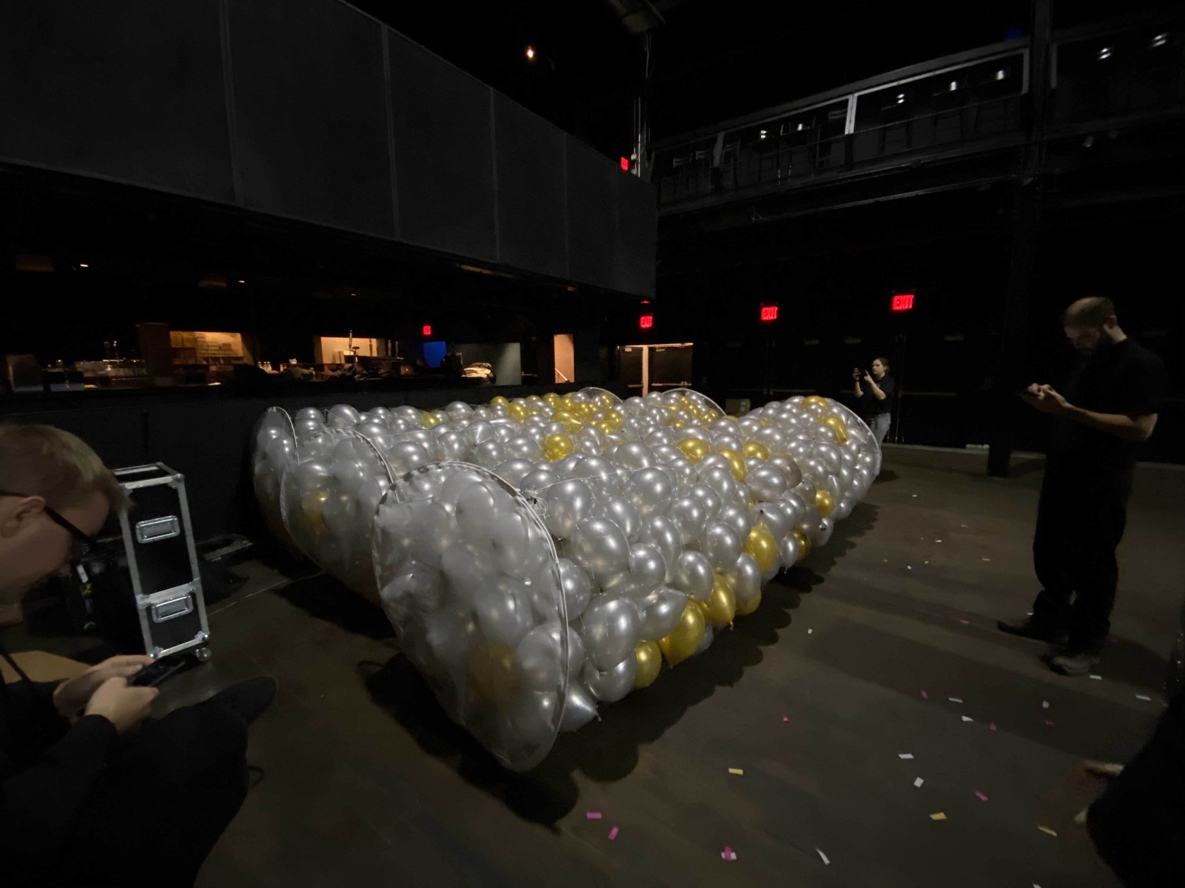 setting up a balloon drop for party