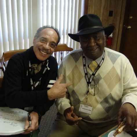 With Bernard Purdee