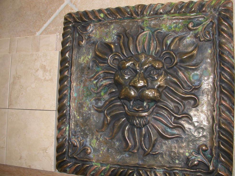 Carved frame metal coated