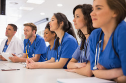Medical students listening sitting at desk at the university