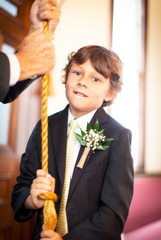Son of the bride rings the church bells