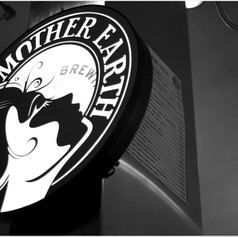 Mother Earth Brewing Logo and Signage