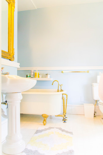 Clawfoot tub in a bright, historic bathroom