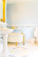 Clawfoot tub in a bright, historic bathroom