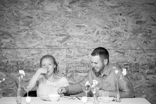 Husband and Wife Eat Reception Dinner