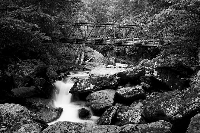 Ansel Adams-esque landsace of a bridge and blurred water on the Appalachia Trail