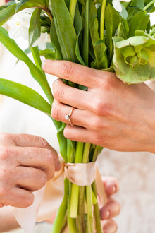 Mother and Daughter's Hands on Bouquet