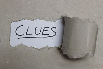 Clues text in torn Paper.jpg