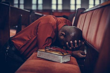 man kneeling in prayer.jpg