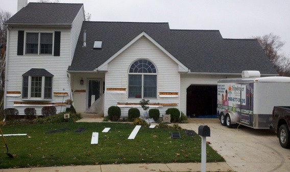 Vinyl siding is removed from each wall section of the home