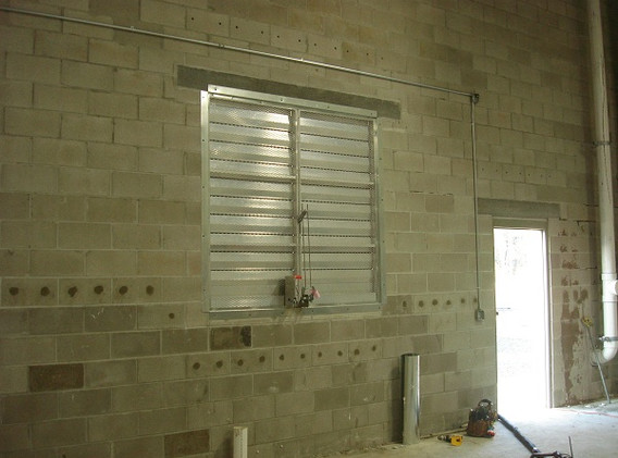 Foam is installed above and below all windows and doors.