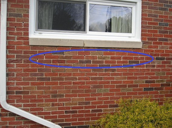 Small holes are drilled into mortar joints