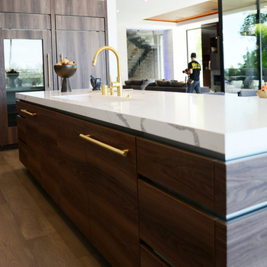 Jaide Matte Textured Nogal with bookmatched island cabinet doors