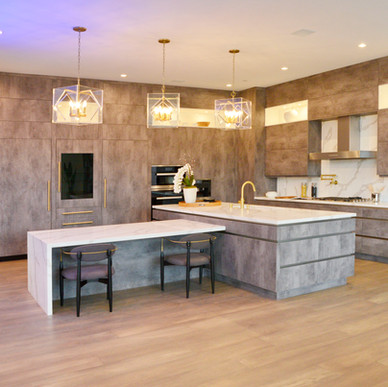 Combining high gloss gold burl pop-out cubicles against matte textured concrete kitchen cabinetry