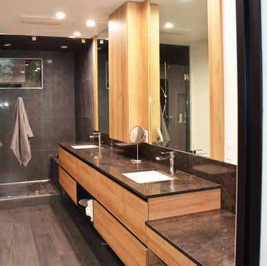 Roble Golden floating master bath sink cabinetry with black integrated hardware pull system