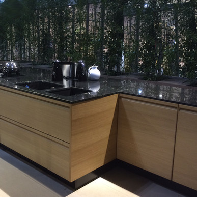 Continuous grain in Roble Golden along modern island base cabinetry