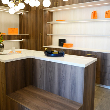 European built-in closet cabinetry with 2 contrasting color tones
