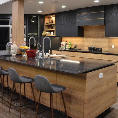 Lava upper cabinetry with Roble Golden base and integrated black hardware pulls