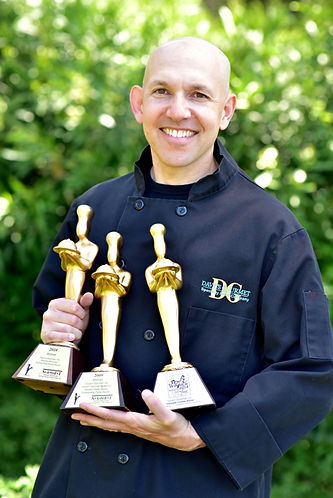 Picture of Dave holding awards