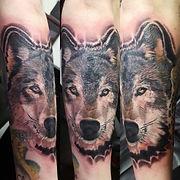 Realistic wolf head tattoo