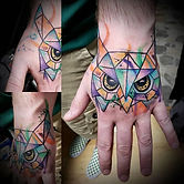 Watercolor Owl hand tattoo.