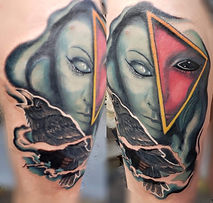Beautiful custom tattoo with raven and womans face.
