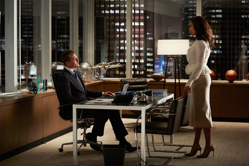 Harvey and Jessica discuss business in his executive New York law office