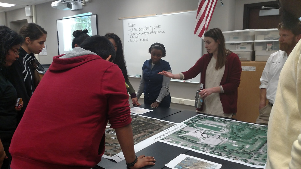 HCA partner Caitlin Dix shares her knowledge of maps with students at East High School as part of Heartland Conservation Alliance's new Green Guard environmental stewardship program