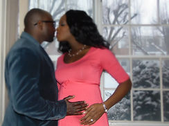 Married couple in a FLEUR OCCASIONS' maternity shoot
