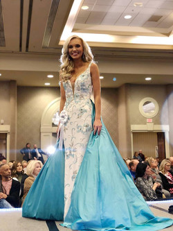 Amber Allen Blue dress on stage fb
