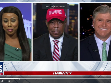 Watch Sean Hannity pander to a couple of black people