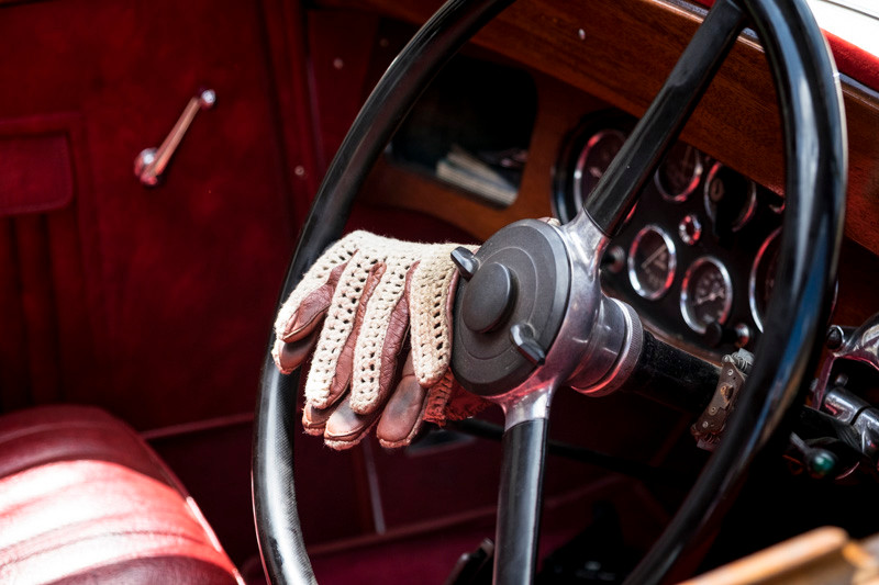 Gloves on the steering wheel classic car
