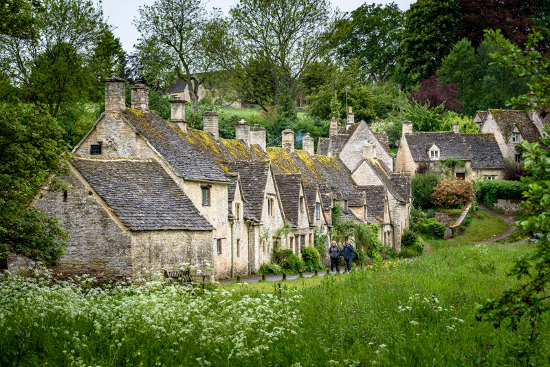 group of aligned cottages in Cotswolds countryside