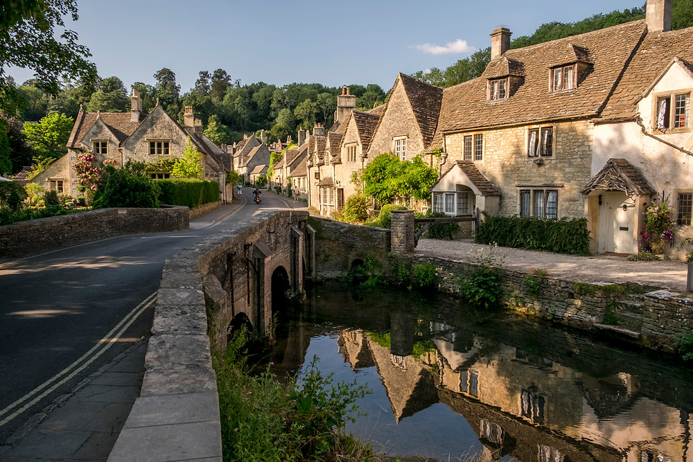 reflection of cottages and bridge in Castle Combe, Cotswolds