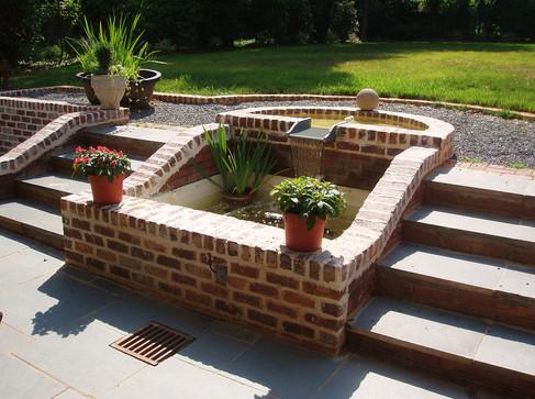 Backyard design featuring koi pond